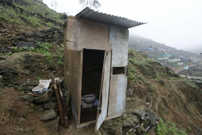 A toilet stands outside the Llamocca family home at Villa Lourdes in Villa Maria del Triunfo on the outskirts of Lima, Peru, October 7, 2015. REUTERS/Mariana Bazo